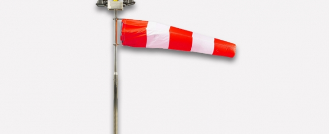 red and white windsock to show wind direction. important for aviation warning